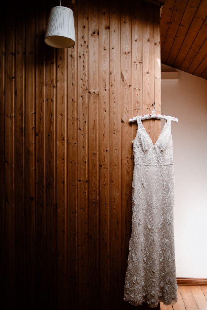 Wedding dress on panelled wall