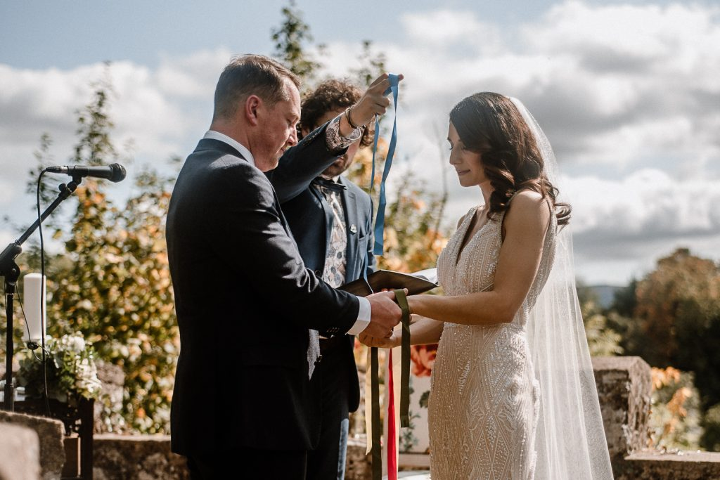 bride and groom do hand fasting