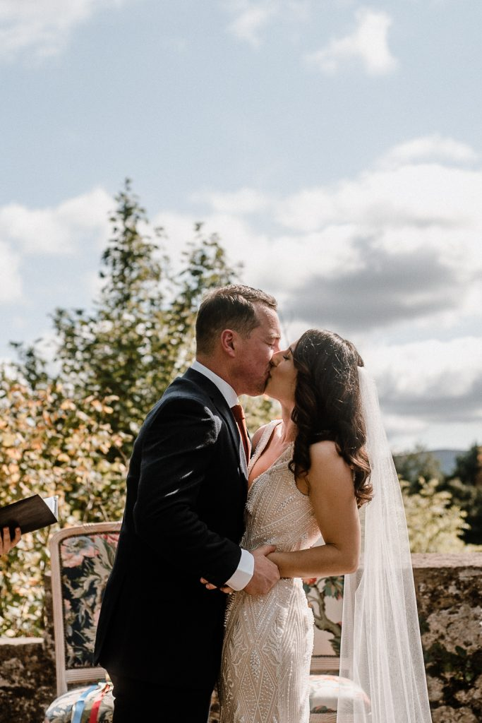 bride and grooms first kiss as a married couple