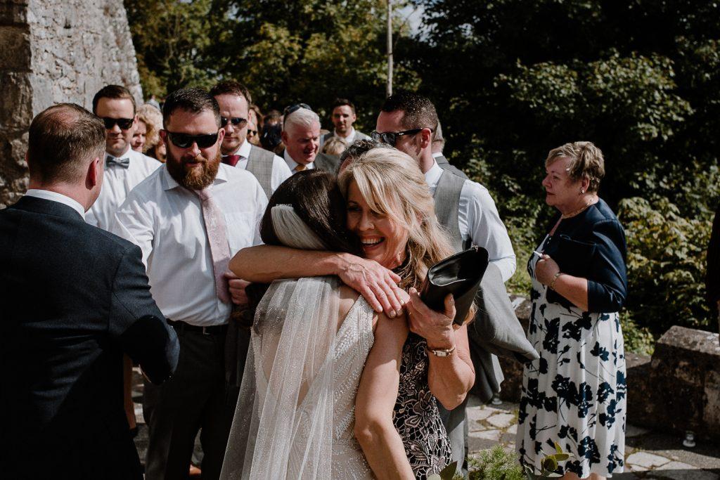 brides mum hugs her