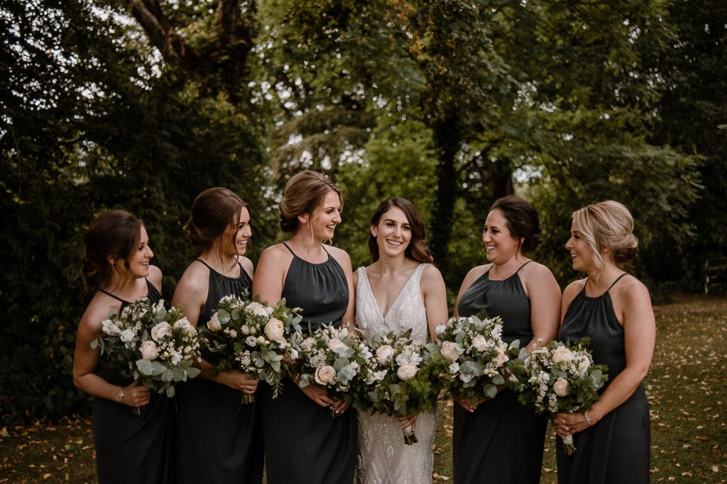 close up of bride and bridesmaids laughing