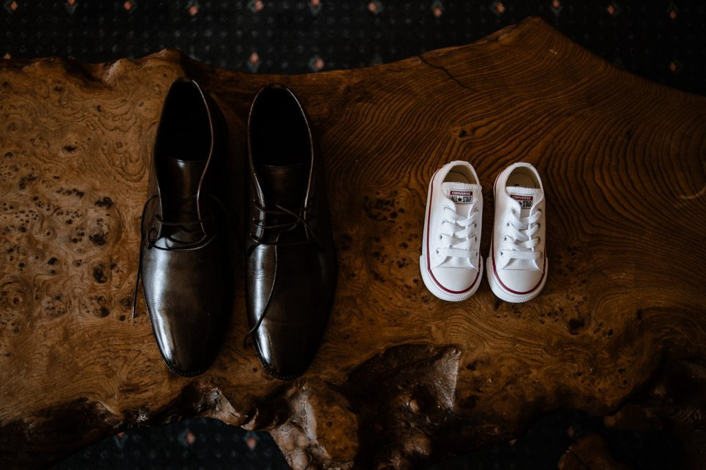 grooms shoes and small babies shoes side by side