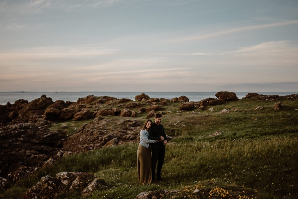 couple hugging in stunning scenery