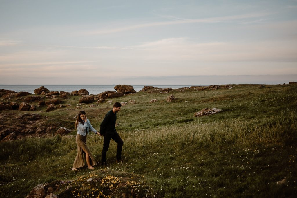 couple walking up hill