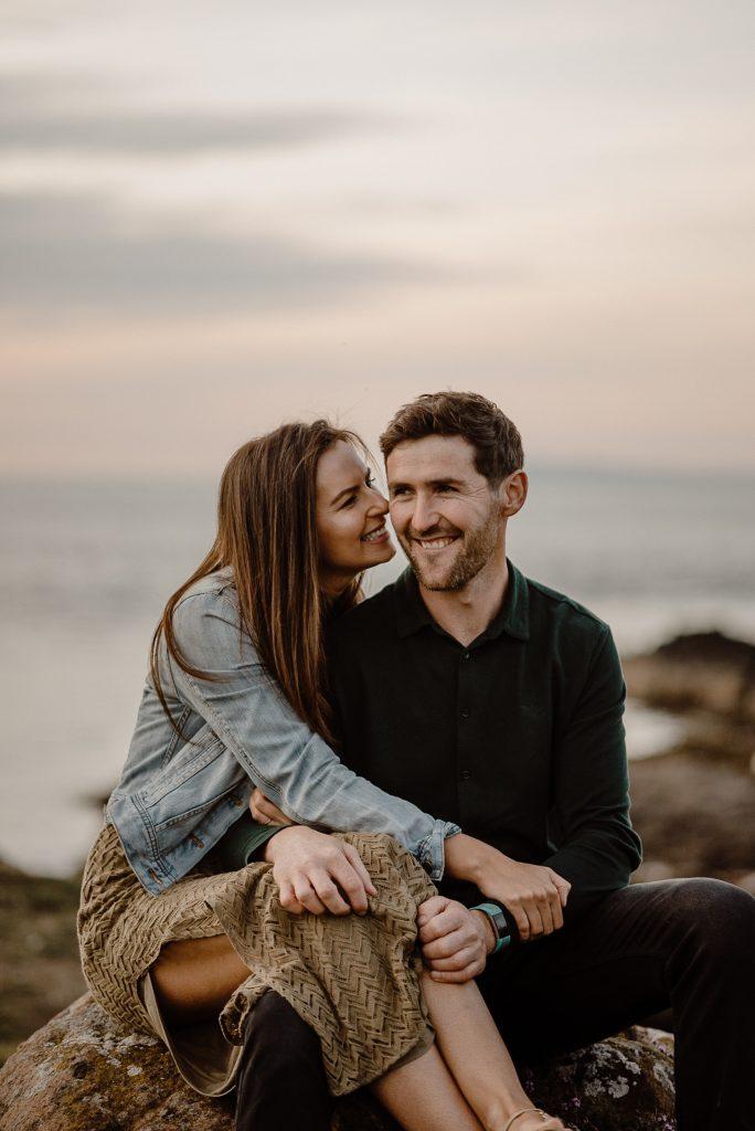 girl laughing beside man