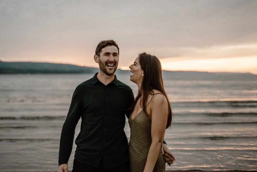 groom laughing beside bridee
