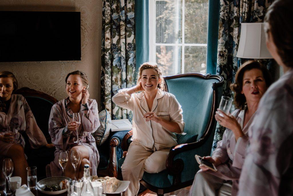 bride smiling with bridesmaids