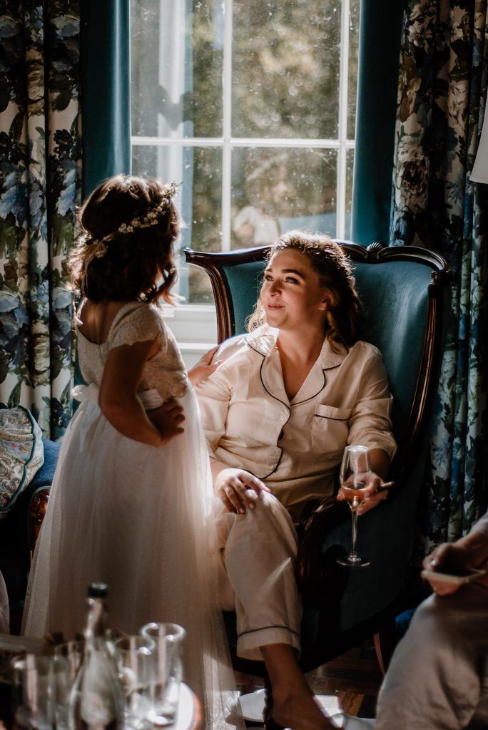 bride chatting to flower girl