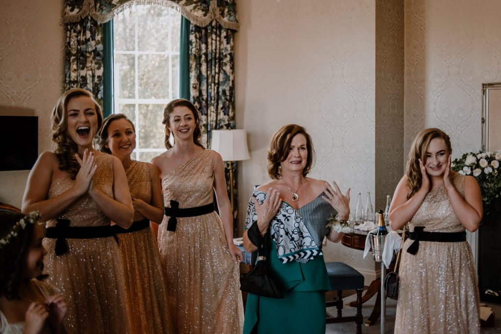 mother of bride seeing bride in dress and feeling emotional