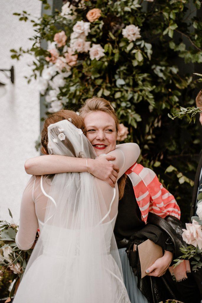 bride hugging pals