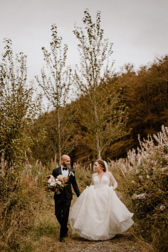 bride and groom walking talking
