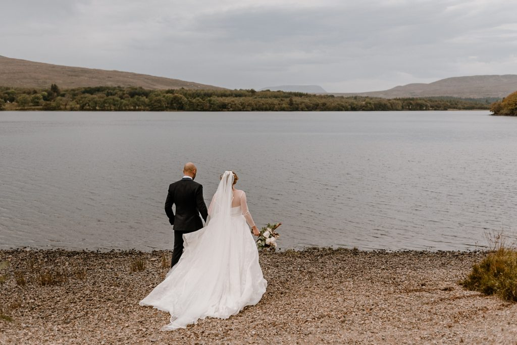 bride and groom taking in lake views
