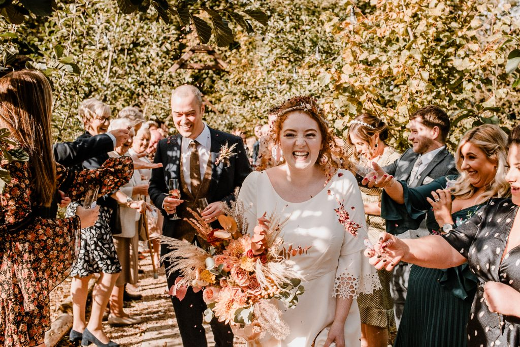 Guests throwing confetti