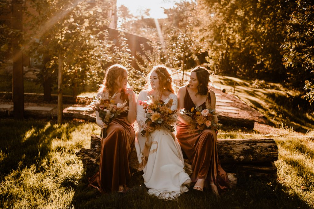 bride and maids sitting in golden light