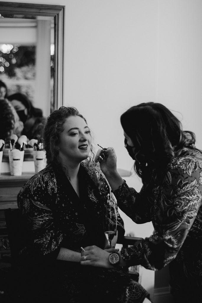 Bride getting make up on